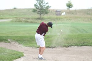 Hawk golfers search for consistency after loss to Dowling Catholic
