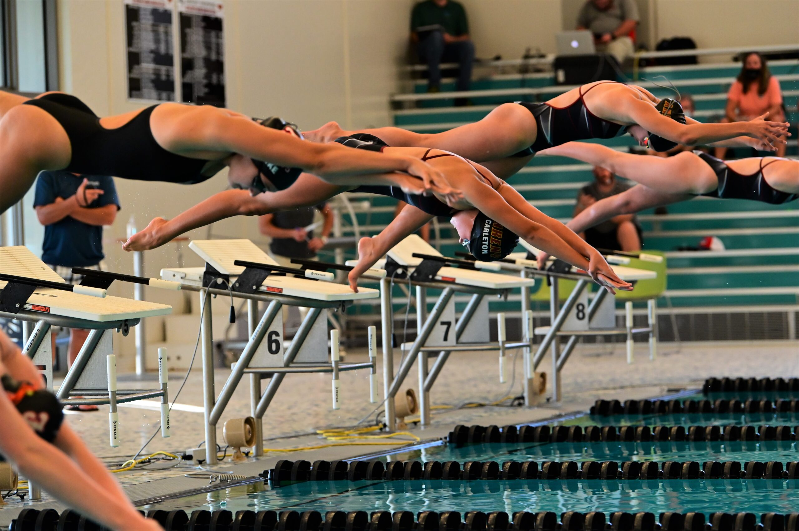 Hawkette swimmers win 10 of 12 events en route to 67-35 victory at Mason City